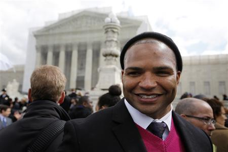 Gay marriage supporter Brendon Ayanbadejo, linebacker for the the Baltimore Ravens of the NFL, talks to reporters in front of the U.S. Supreme Court in Washington, March 26, 2013. REUTERS/Jonathan Ernst
