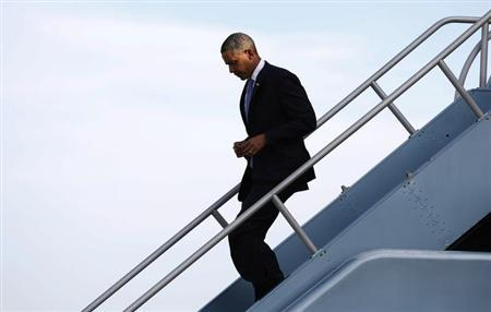 U.S. President Barack Obama descends the steps of Air Force One upon his arrival in San Francisco April 3, 2013. REUTERS/Kevin Lamarque