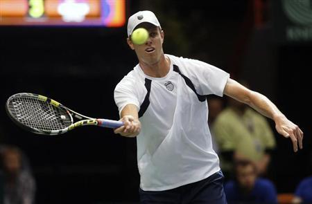 Sam Querrey of the U.S. hits a return to Viktor Troicki of Serbia during their Davis Cup quarter-finals tennis match in Boise, Idaho, April 5, 2013. REUTERS/Jim Urquhart