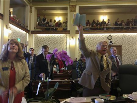 Bozeman Democratic Senator Mike Phillips (R) holds a copy of the Legislature's rule book in Helena, Montana April 5, 2013. REUTERS/Dan Boyce