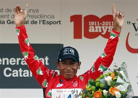 Colombia es Pasion's cyclist Nairo Quintana celebrates on the podium after the seventh and final stage of the Tour of Catalunya cycling race in Barcelona March 27, 2011. REUTERS/Gustau Nacarino