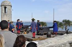 Volunteers re-enact a colonial era canon firing in St Augustine, Florida January 20, 2013, a regular tourist attraction at the 17th century Spanish-built fort San Marcos. REUTERS/Michael Adams