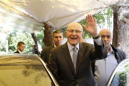 Lebanese former minister Tammam Salam gestures to his supporters in front of his house while going to the presidential palace in Baabda, Beirut April 6, 2013. REUTERS/Mohamed Azakir