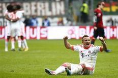 Xherda Shaqiri, do Bayern de Munique, comemora após vencer partida contra o Eintracht Frankfurt pelo campeonato alemão em Frankfurt. Dono da melhor estreia no Campeonato Alemão e do título mais precoce em meio século, o Bayern de Munique voltou ao topo na atual temporada com seu 23º troféu na liga alemã. 06/04/2013 REUTERS/Kai Pfaffenbach