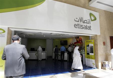 A customer walks out of an Etisalat shop at the Dubai World Trade Centre in Dubai October 14, 2012. Etisalat, the Gulf's No.2 telecommunications operator, will not completely sell out of any of its foreign markets, the company's chief executive said on Sunday. REUTERS/Jumana ElHeloueh