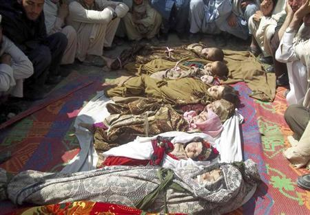 ATTENTION EDITORS - VISUALS COVERAGE OF SCENES OF DEATH AND INJURY Afghan villagers sit near the bodies of children who they said were killed during an air strike in Kunar province April 7, 2013.REUTERS/Stringer