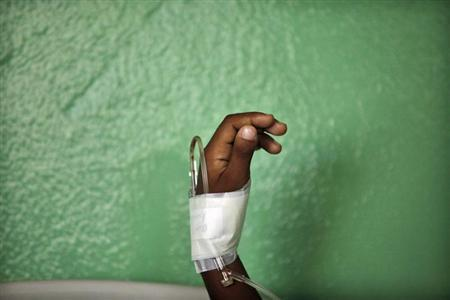 The hand of a child, who has been put on drip after showing symptoms of dengue fever, is seen in the pediatric emergency room of a public hospital in Santo Domingo August 13, 2010. REUTERS/Eduardo Munoz