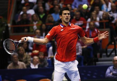 Serbia's Novak Djokovic hits a return to Sam Querrey of the U.S. during their Davis Cup quarter-final tennis match in Boise, Idaho April 7, 2013. REUTERS/Jim Urquhart