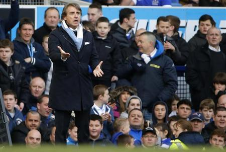 Manchester City's manager Roberto Mancini gestures during their English Premier League soccer match against Everton at Goodison Park in Liverpool, northern England, March 16, 2013. REUTERS/Phil Noble/Files