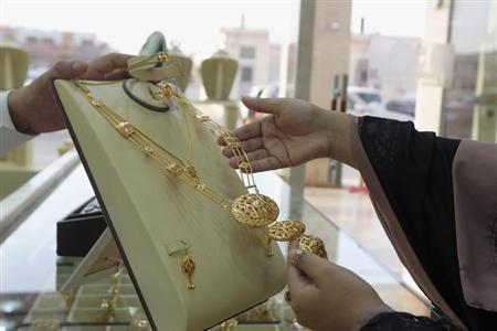 A woman looks at jewellery at a shop in the gold market in Riyadh, March 11, 2013. REUTERS/Stringer/Files
