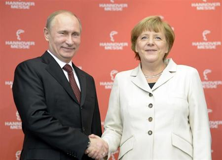 German Chancellor Angela Merkel and Russian President Vladimir Putin shake hands as they officially open the Hanover Messe, industrial trade fair, in Hanover April 7, 2013. REUTERS/Fabian Bimmer