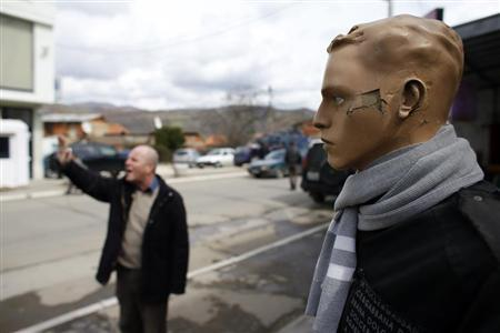 A mannequin is seen as a barricade is set up on the main bridge in the northern Serb dominated part of the ethnically divided town of Mitrovica, April 3, 2013. REUTERS/Marko Djurica