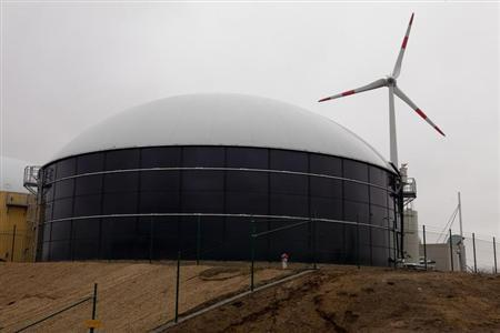 A picture shows a biomass silo and a wind turbine that contribute energy to a hybrid power plant near the town of Schenkenberg north of Berlin, February 29, 2012. REUTERS/Thomas Peter