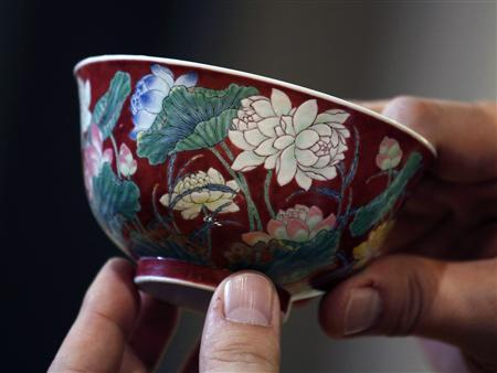 A magnificent Ruby-Ground Falangcai ''Double-Lotus'' Bowl Blue Enamel Yuzhi Mark and Period of Kangxi is shown after Hong Kong Chinese ceramics dealer William Chak has bought it for HK$74 million ($9.5 million) at Sotheby's Spring Sales in Hong Kong April 8, 2013. REUTERS/Bobby Yip