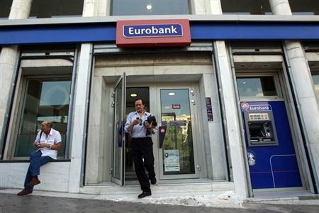 A man comes out of an Eurobank branch in central Athens October 5, 2012. REUTERS/John Kolesidis