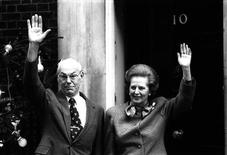 British Prime Minister Margaret Thatcher and husband Denis Thatcher outside her residence at 10 Downing Street, London in this undated file photo. REUTERS/David Osborn/Files