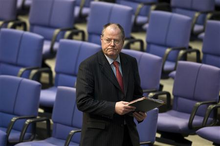 Peer Steinbrueck, Social Democratic Party (SPD) candidate for this year's German general election, arrives for a session of the Bundestag, the German lower house of parliament, on the deployment of German armed forces in Mali, in Berlin February 28, 2013. REUTERS/Thomas Peter