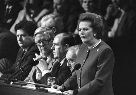 FILE PHOTO - Margaret Thatcher gives the final address of the Conservative Convention in Brighton on October 14, 1988. Listening are L to R: Chancellor of the Exchequer Nigel Lawson, Foreign Secretary Sir Geoffrey Howe, party Chairman Peter Brooke. REUTERS/Andy Clark