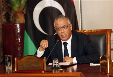 Libya's Prime Minister Ali Zeidan (C) speaks during a joint news conference at the headquarters of the Prime Minister's Office in Tripoli March 31, 2013. REUTERS/Ismail Zitouny