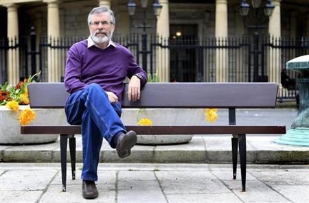 Sinn Fein's Gerry Adams poses for a picture on a bench outside Leinster House in Dublin May 4, 2012. REUTERS/Cathal McNaughton