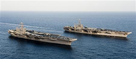 The Nimitz-class aircraft carriers USS John C. Stennis (R) and USS Abraham Lincoln transit during a turnover of responsibility in the Arabian Sea in this U.S. Navy handout photo dated January 19, 2012. REUTERS/U.S. Navy/Mass Communication Specialist 3rd Class Kenneth Abbate/Handout