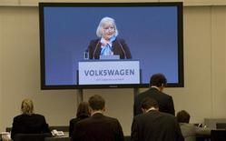 Journalists listen and watch on a screen in the press centre the speech of Ursula Piech, wife of Ferdinand Piech, chairman of the board of German carmaker Volkswagen (not pictured), during the annual shareholders meeting in Hamburg April 19, 2012. REUTERS/Morris Mac Matzen