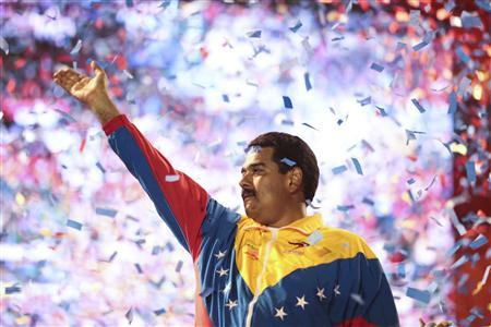 Venezuela's acting President and presidential candidate Nicolas Maduro waves to supporters during a campaign rally at the state of Bolivar, in this picture provided by Miraflores Palace on April 6, 2013. REUTERS/Miraflores Palace/Handout