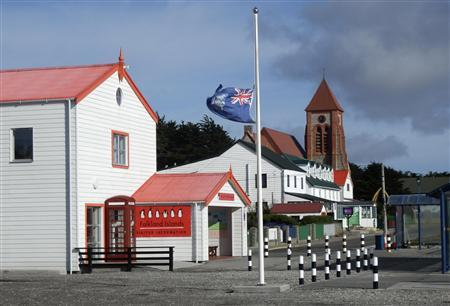 The Falkland Islands flag flies at half mast in front of the Visitor Centre after the death of former British prime minister Margaret Thatcher, in Port Stanley April 8, 2013. REUTERS/Gary Clement