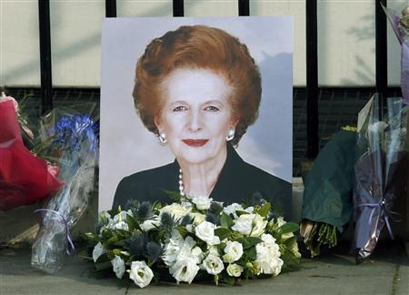 A portrait left by mourners is seen outside the home of former British prime minister Margaret Thatcher after her death was announced in London April 8, 2013. REUTERS/Suzanne Plunkett
