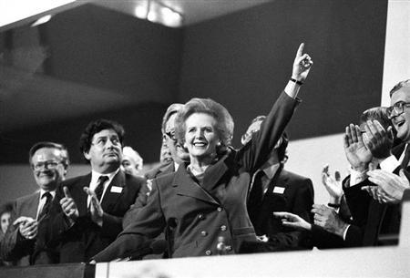 FILE PHOTO - British Prime Minister Margaret Thatcher points skyward as she receives standing ovation at Conservative Party Conference on October 13, 1989. REUTERS/Stringer/UK