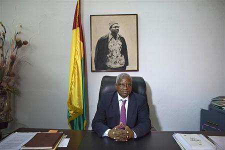 Guinea-Bissau's caretaker President Manuel Serifo Nhamadjo poses for a picture under a portrait of independence hero Amilcar Cabral at his desk at the presidency in the capital Bissau, November 8, 2012. REUTERS/Joe Penney