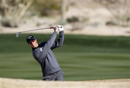 Nicolas Colsaerts of Belgium watches his second shot on the 7th hole during the third round of the WGC-Accenture Match Play Championship golf tournament in Marana, Arizona February 23, 2013. REUTERS/Matt Sullivan