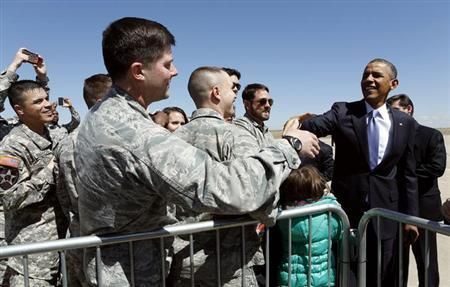 U.S. President Barack Obama greets military personnel upon his arrival at Buckely Air Base in Denver, Colorado April 3, 2013. REUTERS/Kevin Lamarque