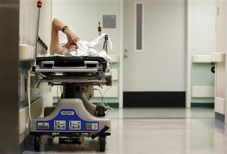 A patient waits in the hallway for a room to open up in the emergency room at a hospital in Houston, Texas July 27, 2009. REUTERS/Jessica Rinaldi