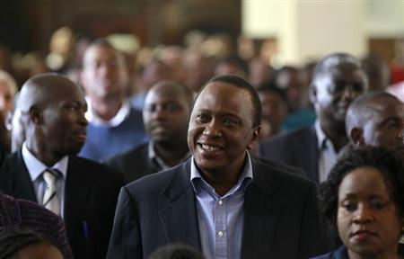 Kenya's newly elected President Uhuru Kenyatta attends the Easter Mass at the Saint Austin's Catholic church in the capital Nairobi, March 31, 2013. REUTERS/Thomas Mukoya