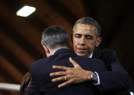 U.S. President Barack Obama hugs Ian Hockley, the father of Connecticut schoolboy Dylan Hockley killed in the Sandy Hook Elementary School shooting, before delivering remarks on measures to reduce gun violence, at the University of Hartford in Connecticut, April 8, 2013. REUTERS/Jason Reed