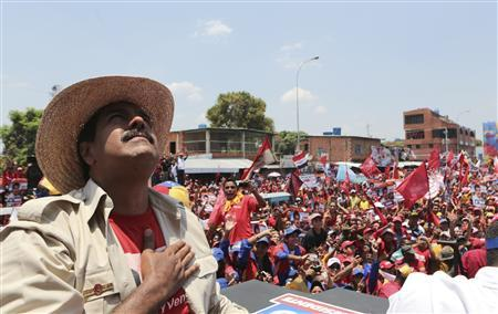 Venezuela's acting President and presidential candidate Nicolas Maduro greets supporters during a campaign rally at the state of Apure, in this picture provided by Miraflores Palace on April 7, 2013. REUTERS/Miraflores Palace/Handout