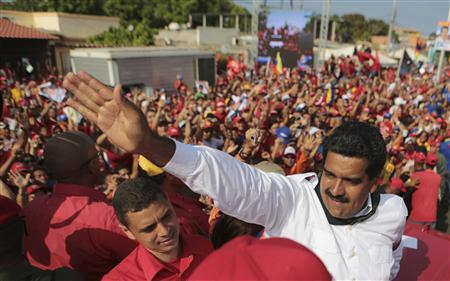 Venezuela's acting President and presidential candidate Nicolas Maduro (R) greets supporters during a campaign rally in Cumana, in the eastern state of Sucre, in this picture provided by Miraflores Palace on April 8, 2013. REUTERS/Miraflores Palace/Handout