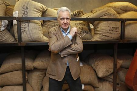 French chef Alain Ducasse poses in front of sacks containing cocoa beans at ''La Manufacture de chocolat'' chocolate workshop in Paris February 19, 2013. REUTERS/Charles Platiau