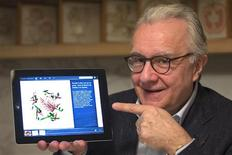 French chef Alain Ducasse poses with an Ipad during an interview with Reuters at the Plaza Athenee Hotel in Paris April 2, 2013. REUTERS/Charles Platiau