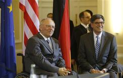German Finance Minister Wolfgang Schaeuble (L) and U.S. Treasury Secretary Jack Lew pose before a news conference after talks in Berlin April 9, 2013. REUTERS/Tobias Schwarz