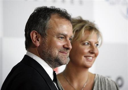 Actor Hugh Bonneville and his wife Lulu Evans arrive at the NBC Universal after-party following the 69th annual Golden Globe Awards in Beverly Hills, California January 15, 2012. REUTERS/Jason Redmond