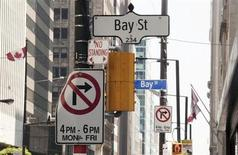Bay Street signs are seen in the heart of the financial district in Toronto, August 17, 2009. REUTERS/Mark Blinch