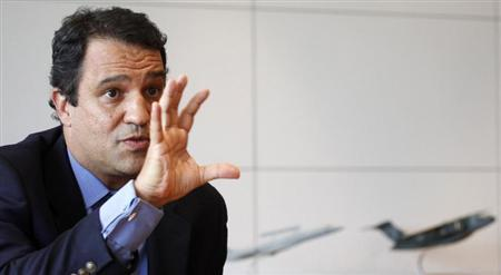 Luiz Carlos Aguiar, the head of Embraer's Defense and Security unit, speaks during an interview with Reuters in Sao Paulo January 13, 2012. REUTERS/Nacho Doce