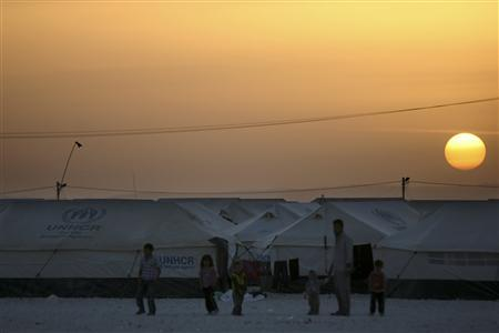 Syrian refugees are seen as U.N. High Commissioner for Refugees (UNHCR) Antonio Guterres visits Al Zaatri refugee camp in the Jordanian city of Mafraq, near the border with Syria March 13, 2013. REUTERS/Muhammad Hamed