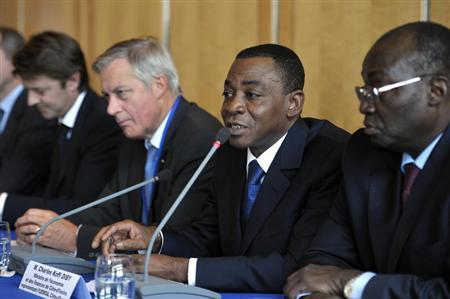 Ivory Coast Finance Minister Charles Koffi Diby (2ndR) speaks as BCEAO Governor Tiemoko Meyliet Kone (R), France's Central Bank governor Christian Noyer (3rdR), France's Finance Minister Francois Baroin (L) attend a news conference at the end of the ''zone franc'' meeting in Paris, September 19, 2011. REUTERS/Philippe Wojazer