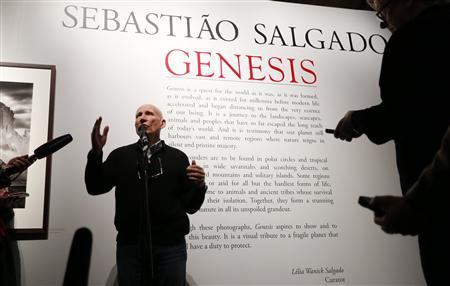 Photographer Sebastiao Salgado talks to reporters at the preview of his exhibition ''Sebastiao Salgado: Genesis'' at the Natural History Museum, in London April 9, 2013. REUTERS/Suzanne Plunkett