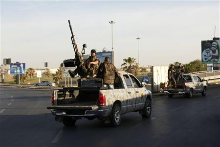 Military vehicles of a joint security force in charge of clearing Tripoli of armed militias are seen April 8, 2013. REUTERS/Ismail Zitouny