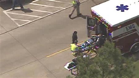 A person is loaded into an ambulance following a mass stabbing at the Cy-Fair campus of Lone Star College in northwest Houston, as seen in this still image from video courtesy of KPRC-TV April 9, 2013. REUTERS/KPRC-TV