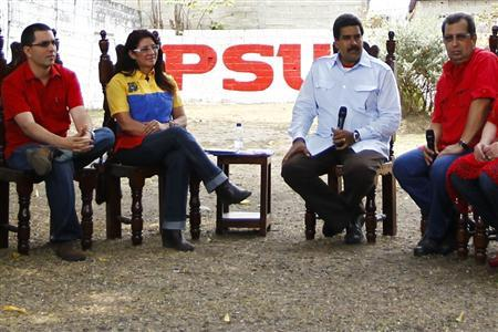 Venezuela's acting President and Presidential candidate Nicolas Maduro (2nd R) and his wife Cilia Flores (2nd L) sit with brother of late President Hugo Chavez, governor of Barinas Adan Chavez (R), and President Chavez's son-in-law, Venezuela's Vice President Jorge Arreaza, as they attend a ceremony in the state of Barinas, April 2, 2013. REUTERS/Carlos Garcia Rawlins